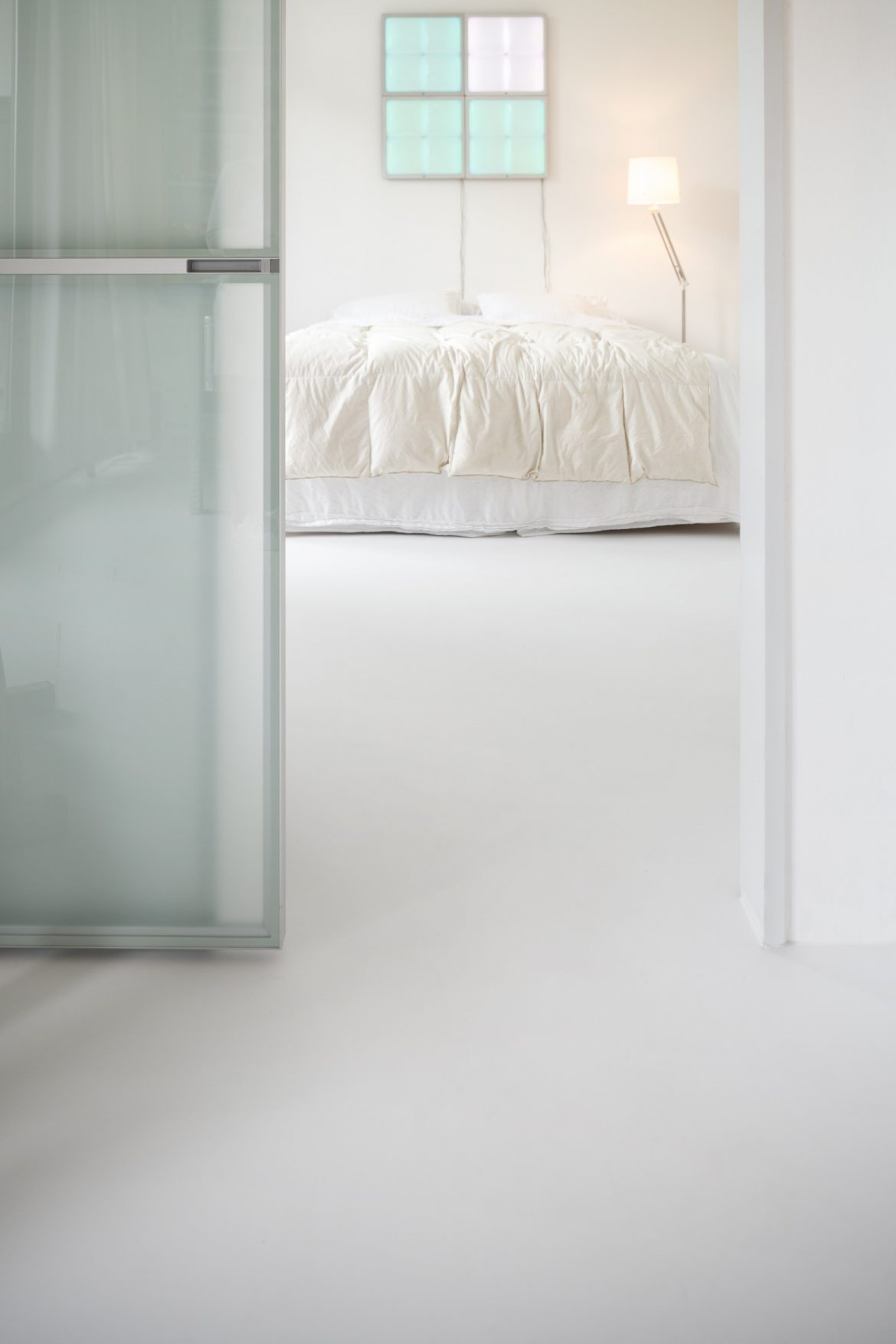 Witte gietvloer Rotterdam slaapkamer