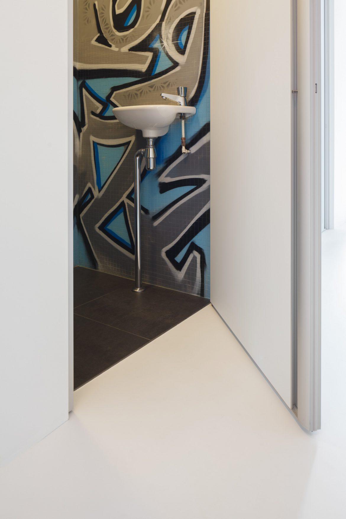 Witte gietvloer toilet Rotterdam